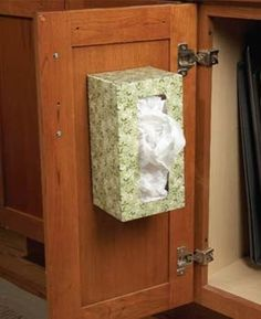 empty tissue box attached to inside of cabinet door to hold plastic grocery bags + more kitchen organization ideas