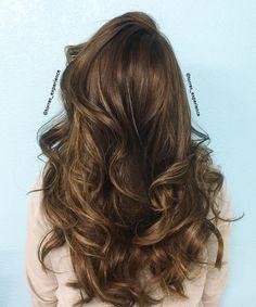 Medium brown hair with Natural highlights