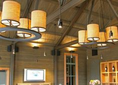 The three pendants add articulated detail while illuminating the large volume of this winery tasting room. — at Alpha Omega Winery.