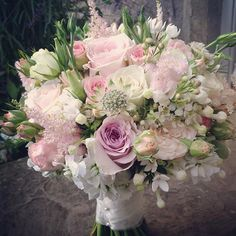 Sweet Avalanche by Meijer Roses in a wedding bouquet