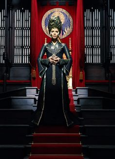 Seraphina Picquery the President of MACUSA stands in front of her President's Throne wearing black and gold robes and an impressive headdress Horned Serpent Ilvermorny, Seraphina Picquery, Barty Crouch Jr, Gellert Grindelwald, Male Witch, Hp Harry Potter, Black Goddess, Fantastic Beasts And Where, Sirius Black