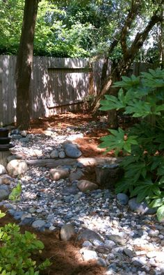 Like the railroad ties, dry creek bed, shade plants, pine mulch
