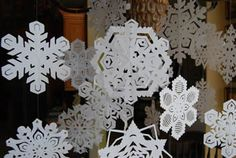 Directions how to make snowflakes and transform a room. Remember the movie Elf?