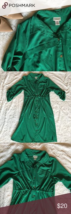 Green Maternity Shirt Dress Very flattering shirt dress that can be cinched tightly over your bump. The pictures don't do the justice. It's a very rich dark green, and has bronze buttons down the front. One small snag located across the breast pocket fold. Dress also has hidden pockets! Good used condition. Motherhood Maternity Dresses