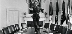 First lady,Betty Ford, striking a pose on the  White House cabinet room conference table,on the last day of her husband's Presidency. Betty Ford advocated for the Women's Equal Pay ,Equal Rights bills and started the Betty Ford Treatment Center ,the first of it's kind.