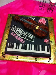 Music themed Piano and Cello cake. 21st -Piano-Cello cake- all cake covered with fondant.
