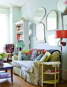 The pale walls and colorful painted furniture and textiles.