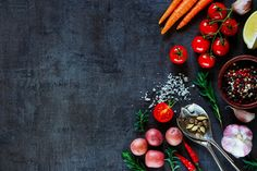 Organic vegetables for cooking - Spices, herbs and fresh vegetables for cooking on dark metal background with space for text. Top view. Bio Healthy food ingredients.