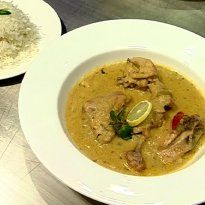 Chicken Khada Masala: Chicken pieces cooked in a creamy paste of yoghurt, spices and onions. Served with boiled rice.