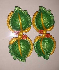 Green leaf diya Diya Decoration Ideas, Diy Diwali Decorations, Festival Decorations, Diya Designs, Rangoli Designs Diwali, Diwali Diya, Diwali Craft, Crafts For Kids, Arts And Crafts
