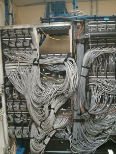 Not really cable management, but a picture of the networking racks in a Houston community college. All the bandwidth in that campus is running through that single fiber line.