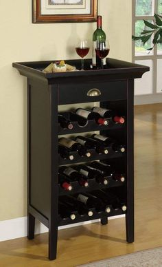 """Wine Cabinet in Black with Merlot Rub Through Powell Wine Cabinet is the perfect piece for a wine enthusiast. Crafted with Black with """"Merlot"""" rub through finish, this cabinet can properly store 16 bottles of wine. A single drawer is the per Wine Bottle Rack, Bottle Holders, Wine Rack Inspiration, Standing Wine Rack, Wine Rack Design, Wine Cabinets, Italian Wine, Wine Storage, Diy Wine Racks"""