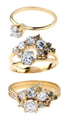 This incredible Custom Ombré Heirloom Cluster Ring Set features a .50ct old mine cut heirloom diamond in a custom solitaire setting, paired with a custom cluster ring jacket. We mix heirloom diamonds and ethically-sourced colored gems arranged from light to dark to create an ombré effect. Shown in 14kt yellow gold in a satin finish.