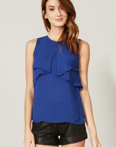 Royal blue tank top with a ruffle detail in the front. Layered detail in the back. Button closure.