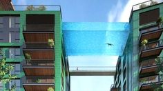 This is an artist's rendering of the soon-to-be-constructed glass-bottomed swimming pool at the Embassy Gardens apartment complex in London (previously: these pool balconies and this pool bridge). The all glass pool will sit above the ground, have. Pool Bridge, Glass Bridge, Glass Bottom Pool, Pool Piscina, Sky Pool, Apartment Complexes, Beautiful Homes, Dubai, Architecture Design