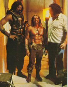 "Whose the little guy in the middle? It's Arnold flanked by Wilt ""the Stilt"" Chamberlain and Andre the Giant."