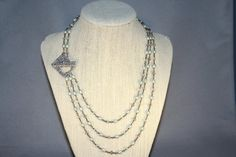 Mint Sorbet Necklace     Cool off with this sweet treat... This necklace is a show stopper with it's asymmetrical design of three rosary linked
