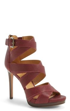 Flattering crisscrossed straps and a double-layer platform make this flirty sandal just right for a night out. Style with a black body-con dress and a bordeaux-hue clutch for the perfect outfit to hit up the town.