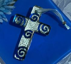 Murano style cross collection blue and silver swirl design - Our handcrafted Murano like glass crosses are stunning and will wow your guests with it's elegance and style.  http://www.favorfavorbaby.com/p-DC5106.htm