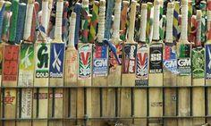 A row of cricket bats on sale at a street side shop. Cricket Bat, Spikes, Cherries, Bats, Spinning, British, Seasons, Sport, Street