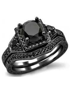 Halloween Wedding Ring Inspiration. black diamonds!   ---   Already have a ring, but this is sooo gorgeous!!!