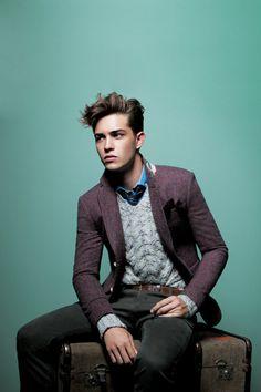 Classic men's style, blue shirt, grey cardigan, dark grey trousers and burgundy blazer