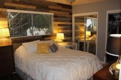 How to Install a DIY Wooden Pallet Wall - Easy, Inexpensive Bedroom Makeover - Country Living Pallet Wall Bedroom, Wooden Pallet Wall, Faux Wood Wall, Pallet Wall Decor, Wooden Diy, Wood Pallets, Diy Pallet, Pallet Walls, Pallet Ideas