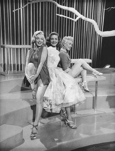 Marilyn Monroe, Betty Grable and Lauren Bacall on the set of How To Marry a Millionaire, 1953.