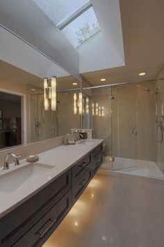 Vollinger residence contemporary bathroom Here the sconces are ON the mirrors, and the mirror is virtually frameless.  This may not be a bad look..