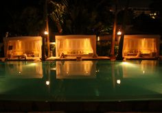 I love super sexy Miami, baby.  Let's be shallow and drink champagne while swimming in the pool.    Delano Hotel Swimming Pool at Night - South Beach, FL by ChrisGoldNY, via Flickr