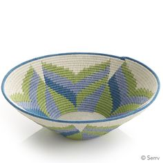 Protea Flower Basket | Each of Tintsaba's decorative baskets takes 30-50 hours to complete. They are meticulously hand crafted by rural women artisans who wrap colorful sisal threads around the basket's dense coils. The bright floral design is inspired by the Protea, a type of flowering African plant. Patterns will vary slightly. serrv.org