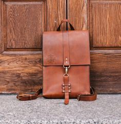 Introducing The Bootlegger Leather Backpack from The Speakeasy Leather Co. Hand made in the U.S.A with 100% American Leather and features bonded polyester thread for durability and is hand dressed and