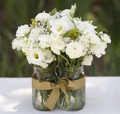 Mason Jar Centerpiece - Like the grouping with flowers and ribbons--other tables could be floating candles...