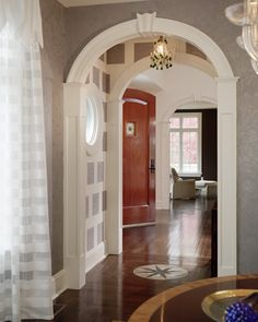 I love the simple arch way! Plus, the change in wall covering is fabulous!  Dream home!