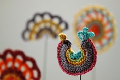 A fun crocheted decorative bird on a wire. by crochetclare on Etsy