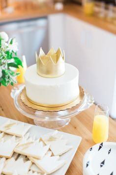 gold crown cake for a Where the Wild Things Are Baby Shower  Photography : Heather Rowland Photography Read More on SMP: http://www.stylemepretty.com/living/2016/10/24/where-the-wild-things-are-inspired-baby-shower/