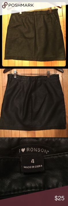 Size 4 black faux leather mini skirt Black faux leather mini skirt. Size 4. Front pockets. High quality. Skirts Mini