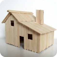 ALSO A CUTE BARN    Little House made of popsicle sticks--complete with loft and ladder