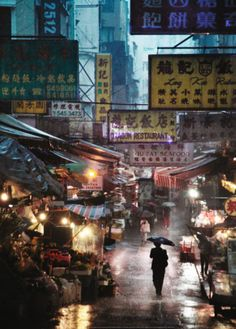 Market under the Rain, Honk Kong, c.2009 by Christophe Jacrot. Art print from Art.com.