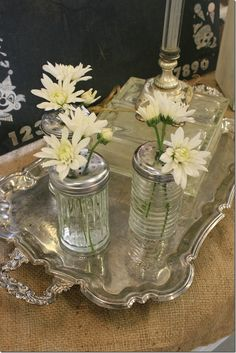 sugar or parmesan shakers adorned w/ just a few blooms...hmmm... this could be inexpensive & fun w/ different flowers!