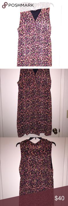 Plus size sleeveless knee length dress Light weight. Perfect summer dress for the office. Button detail at bust. Collared. Worn just a couple times. Like new. torrid Dresses