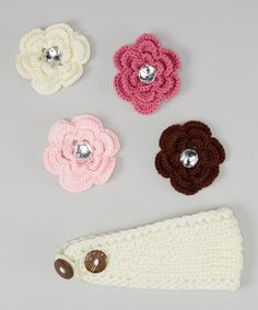 This set has all of the essentials for little lovelies to deck out their noggins in adorable style. A delicately knit headband offers plenty of style and warmth, while some shimmering flower clips keep hairdos in place throughout the day.Includes one headband and four clipsHeadband: 16'' diameterJewel flower clips: 3'' diameter eachPolyesterHand washImported