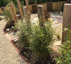 Radial sandstone paving, upright oak sleepers and corten fire pit