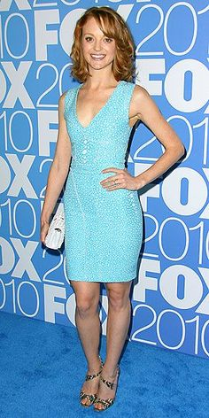 The Glee guidance counselor shows her sexier side in a plunging blue Brian Reyes dress, metallic sandals and white patent Jimmy Choo clutch at the FOX 2010 Programming Presentation in N.Y.C.