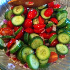 Baby Cucumbers, Cherub Tomatoes, Finely Diced Red Onion, 2 tbs Olive Oil, Vinegar to your taste, Salt and Black Pepper.  Chill while you are cooking Dinner!!