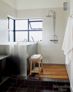 Soaking tub . . . shower with wooden floor