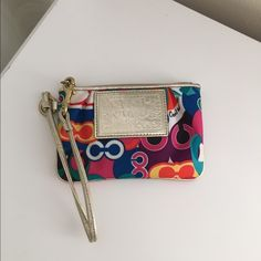 Coach Poppy multicolor wristlet Gently used multicolor wristlet from Coach's Poppy collection Coach Bags Clutches & Wristlets