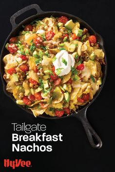 Feed your hungry crowd with this skillet of loaded breakfast nachos that uses kettle-cooked potato chips instead of tortilla chips. Homemade Breakfast, Breakfast Recipes, Breakfast Nachos, Cast Iron Griddle, White Cheddar Cheese, Salsa Verde, Tortilla Chips, Potato Chips, Cherry Tomatoes