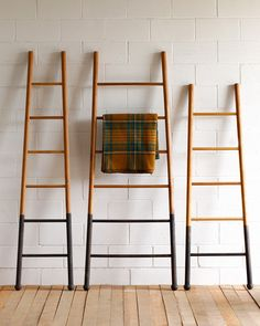 """Lostine Bloak wooden ladder dip dyed oak $475.00 Based on orchard ladders used in picking apples and pears. Our """" Bloak"""" Ladders are made of solid white oak and dipped in an oxide to blacken the bottom. Use them to display blankets, towels or scarves .usa"""