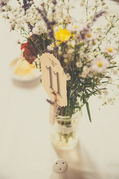 wild flower wedding decor - Read more on One Fab Day: http://onefabday.com/castle-oliver-wedding-by-chemistry-photography/